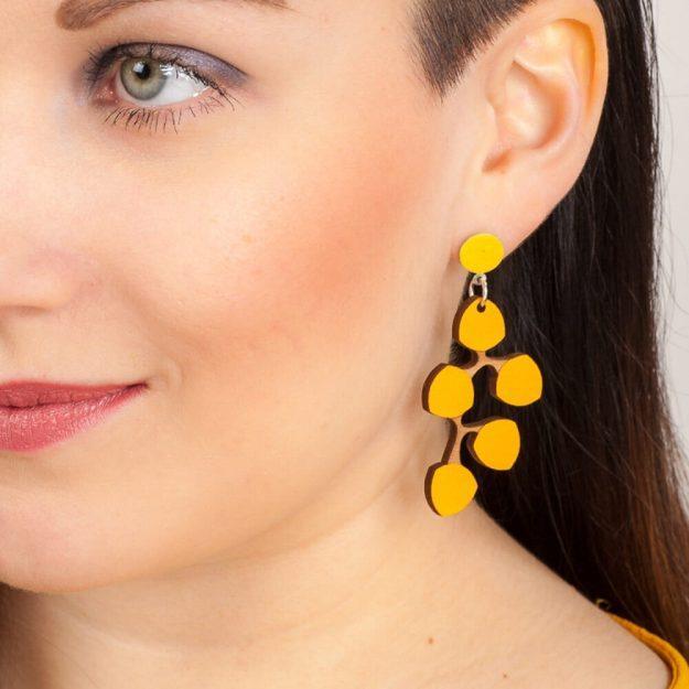 Woman wearing yellew Snowberry Desing Earrings