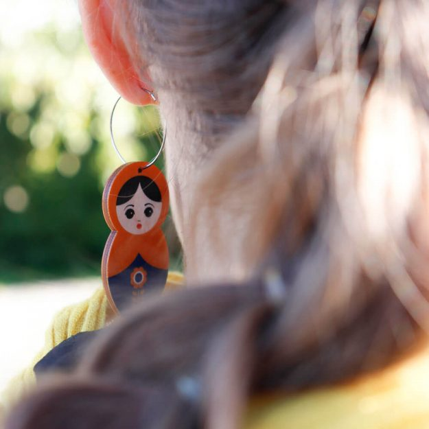 Wooden Matryoshka Earrings and woman